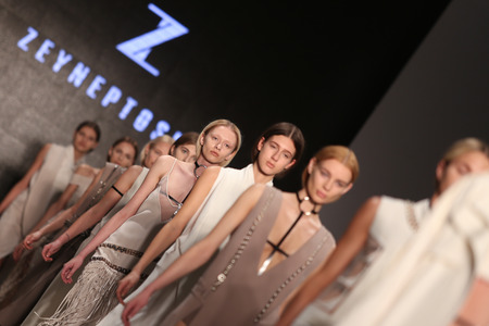 the latest models: ISTANBUL, TURKEY - MARCH 19, 2015: Models showcase the latest creations by Zeynep Tosun in Mercedes-Benz Fashion Week Istanbul