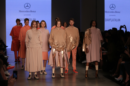 the latest models: ISTANBUL, TURKEY - MARCH 20, 2015: Models showcase the latest creations by David Catalan in Mercedes-Benz Fashion Week Istanbul