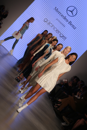 the latest models: ISTANBUL, TURKEY - MARCH 20, 2015: Models showcase the latest creations by Gulcin Cengel in Mercedes-Benz Fashion Week Istanbul