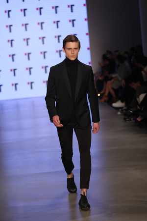 fashion week: ISTANBUL, TURKEY - MARCH 20, 2015: A model showcases one of the latest creations by Tween in Mercedes-Benz Fashion Week Istanbul