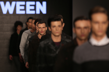 the latest models: ISTANBUL, TURKEY - MARCH 20, 2015: Models showcase the latest creations by Tween in Mercedes-Benz Fashion Week Istanbul