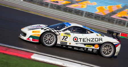 ferrari: ISTANBUL, TURKEY - OCTOBER 25, 2014: Vadim Gitlin drives Ferrari 458 Challenge EVO of Kessel Racing Team during Ferrari Racing Days in Istanbul Park Racing Circuit