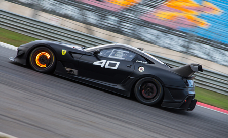 programmes: ISTANBUL, TURKEY - OCTOBER 25, 2014: C. Ruud drives Ferrari 599XX during XX Programmes of Ferrari Racing Days in Istanbul Park Racing Circuit Editorial