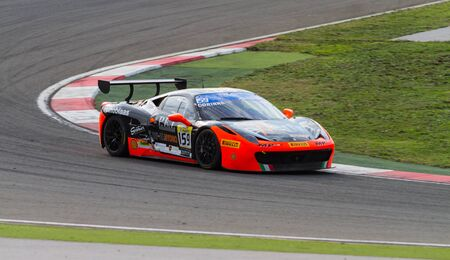 p f: ISTANBUL, TURKEY - OCTOBER 26, 2014: Corinna Gostner drives Ferrari 458 Challenge EVO of Ineco MP Racing Team during Ferrari Racing Days in Istanbul Park Racing Circuit Editorial