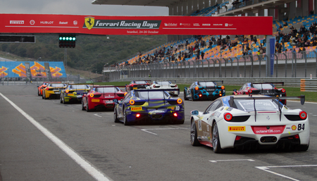 ferrari: ISTANBUL, TURKEY - OCTOBER 26, 2014: Ferrari 458 Challenge during Ferrari Racing Days in Istanbul Park Racing Circuit