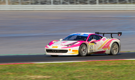 ISTANBUL, TURKEY - OCTOBER 25, 2014: Giacomo Stratta drives Ferrari 458 Challenge EVO of Forza Service Racing Team during Ferrari Racing Days in Istanbul Park Racing Circuit 스톡 콘텐츠