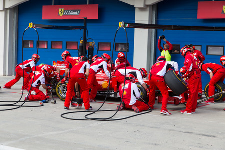 ferrari: ISTANBUL, TURKEY - OCTOBER 26, 2014: Pit stop of Formula 1 car in Ferrari Racing Days in Istanbul Park Racing Circuit