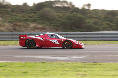 programmes: ISTANBUL, TURKEY - OCTOBER 26, 2014: B. Dransmann drives Ferrari FXX during XX Programmes of Ferrari Racing Days in Istanbul Park Racing Circuit Editorial