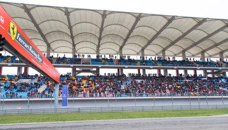 racing car: ISTANBUL, TURKEY - OCTOBER 26, 2014: Audience of Ferrari Racing Days in Istanbul Park Racing Circuit