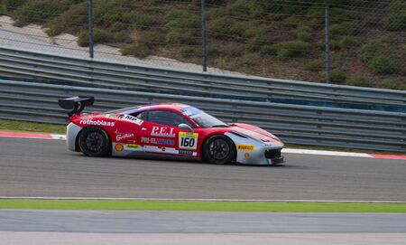mp: ISTANBUL, TURKEY - OCTOBER 26, 2014: Manuela Gostner drives Ferrari 458 Challenge EVO of Ineco MP Racing Team during Ferrari Racing Days in Istanbul Park Racing Circuit Editorial