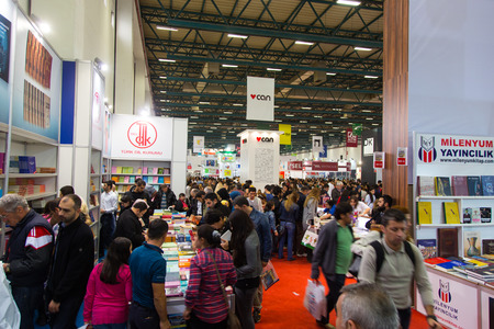 the publisher: ISTANBUL, TURKEY - NOVEMBER 09, 2014: People in Istanbul Book Fair. 33rd International Istanbul Book Fair held in Tuyap Fair and Convention Center.