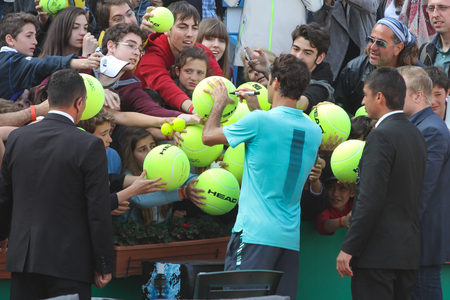 paribas: ISTANBUL, TURKEY - MAY 01, 2015: Swiss player Roger Federer signs to fans after quarter final match of TEB BNP Paribas Istanbul Open 2015