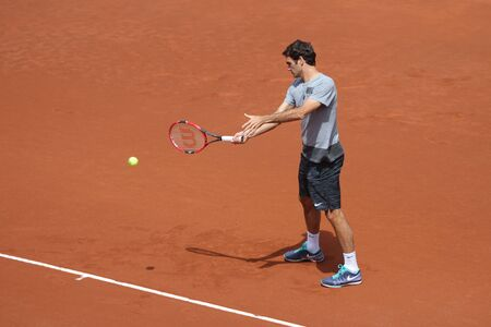 paribas: ISTANBUL, TURKEY - MAY 02, 2015: Swiss player Roger Federer in action during warmup match against Turkish player Cem İlkel in TEB BNP Paribas Istanbul Open 2015