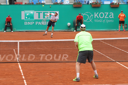 atp: ISTANBUL, TURKEY - MAY 02, 2015: Dusan Lajovic and Radu Albot against Chris Guccione and Andre Sa in doubles semi-final match of TEB BNP Paribas Istanbul Open 2015 Editorial