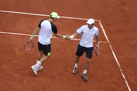 paribas: ISTANBUL, TURKEY - MAY 02, 2015: Dusan Lajovic and Radu Albot against Chris Guccione and Andre Sa in doubles semi-final match of TEB BNP Paribas Istanbul Open 2015 Editorial