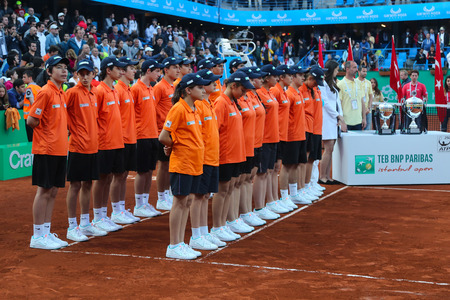 atp: ISTANBUL, TURKEY - MAY 03, 2015: Ball Boys and Girls in award ceremony of TEB BNP Paribas Istanbul Open 2015