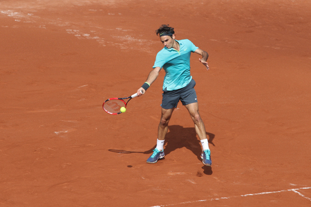 atp: ISTANBUL, TURKEY - MAY 01, 2015: Swiss player Roger Federer in action during quarter final match against Spanish player Daniel Gimeno-Traver in TEB BNP Paribas Istanbul Open 2015