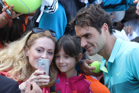 paribas: ISTANBUL, TURKEY - MAY 01, 2015: Swiss player Roger Federer take selfie with his fans after quarter final match of TEB BNP Paribas Istanbul Open 2015