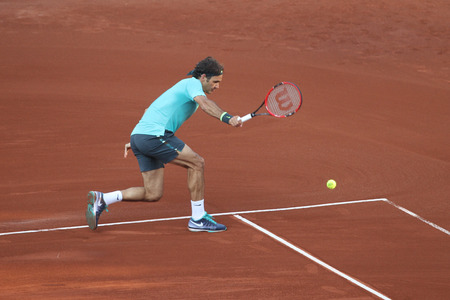 paribas: ISTANBUL, TURKEY - MAY 03, 2015: Swiss player Roger Federer in action during final match against Uruguayan player Pablo Cuevas in TEB BNP Paribas Istanbul Open 2015 Editorial