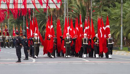 ISTANBUL, TURKEY - OCTOBER 29, 2014: Soldiers march with flags in Vatan Avenue during 29 October Republic Day celebration of Turkey