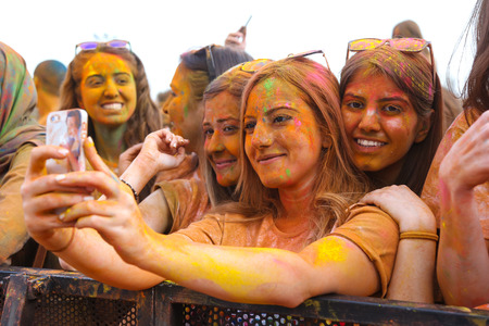 ISTANBUL, TURKEY - MAY 17, 2015: Girls take selfie and have fun in colors during Color Up Run, Istanbul