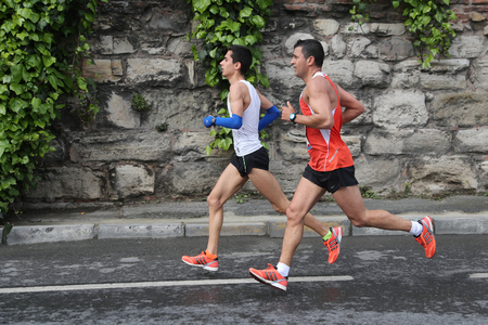 ISTANBUL, TURKEY - APRIL 26, 2015: Athletes are running in Old Town streets of Istanbul during Vodafone 10th Istanbul Half Marathon