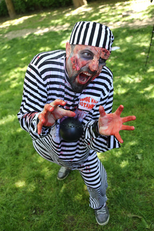 ISTANBUL, TURKEY - MAY 10, 2015: Man in convict costume during zombie walk Istanbul in Nisantasi Park 報道画像