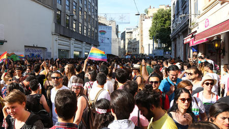 intervene: ISTANBUL, TURKEY - JUNE 28, 2015: LGBT Pride Istanbul was banned by the Istanbul Municipality, so police intervene in with tear gas and water cannons in Istiklal Avenue
