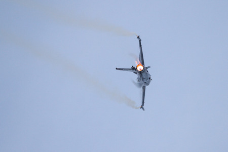 turk: ISTANBUL, TURKEY - MAY 17, 2015: Turkish Air Force Solo Aerobatics Display Team Solo Turk performs. Solo Turk airplane is a F-16 C Blok-40 fighter jet.