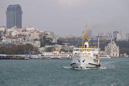 seaway: ISTANBUL, TURKEY - NOVEMBER 01, 2014: Sehir Hatlari ferry in Bosphorus Strait. Sehir Hatlari was established in 1844 and now carry 150,000 passengers a day.