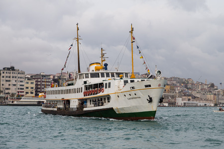 eminonu: ISTANBUL, TURKEY - OCTOBER 29, 2014: Sehir Hatlari ferry passing to Eminonu from Asian side of Istanbul. Sehir Hatlari was established in 1844 and now carry 150,000 passengers a day.