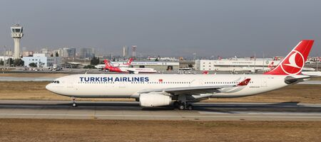 tk: ISTANBUL, TURKEY - JULY 09, 2015: Turkish Airlines Airbus A330-343 (CN 1311) takes off from Istanbul Ataturk Airport. THY is the flag carrier of Turkey with 284 fleet size and 275 destinations Editorial
