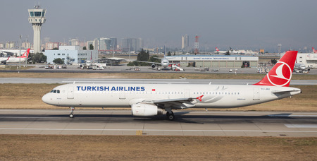 thy: ISTANBUL, TURKEY - JULY 09, 2015: Turkish Airlines Airbus A321-231 (CN 4788) takes off from Istanbul Ataturk Airport. THY is the flag carrier of Turkey with 284 fleet size and 275 destinations Editorial