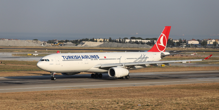 thy: ISTANBUL, TURKEY - JULY 09, 2015: Turkish Airlines Airbus A330-343 (CN 1298) takes off from Istanbul Ataturk Airport. THY is the flag carrier of Turkey with 284 fleet size and 275 destinations