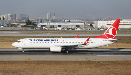 thy: ISTANBUL, TURKEY - JULY 09, 2015: Turkish Airlines Boeing 737-8F2 (CN 29785544) takes off from Istanbul Ataturk Airport. THY is the flag carrier of Turkey with 284 fleet size and 275 destinations Editorial