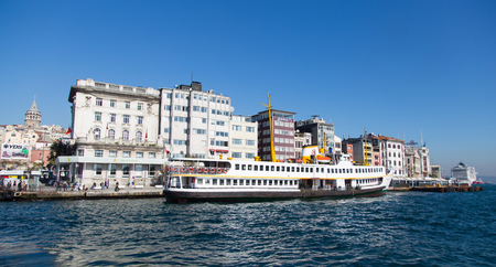 bosporus: ISTANBUL, TURKEY - NOVEMBER 05, 2014: Sehir Hatlari ferry in Karakoy passenger port. Sehir Hatlari was established in 1844 and now carry 150,000 passengers a day.