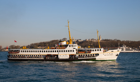 liner transportation: ISTANBUL, TURKEY - APRIL 12, 2015: Sehir Hatlari ferry passing from Asian side to European side of Istanbul. Sehir Hatlari was established in 1844 and now carry 150,000 passengers a day. Editorial