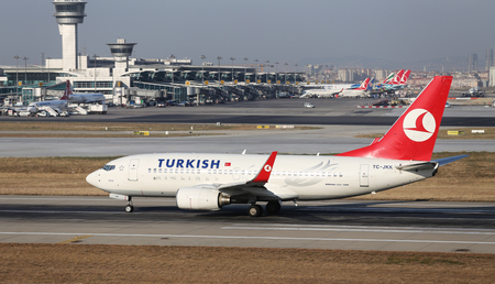 tk: ISTANBUL, TURKEY - JULY 09, 2015: Turkish Airlines Boeing 737-752 (CN 342981812) takes off from Istanbul Ataturk Airport. THY is the flag carrier of Turkey with 284 fleet size and 275 destinations Editorial