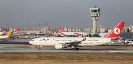 tk: ISTANBUL, TURKEY - JULY 09, 2015: Turkish Airlines Airbus A330-203 (CN 463) takes off from Istanbul Ataturk Airport. THY is the flag carrier of Turkey with 284 fleet size and 275 destinations