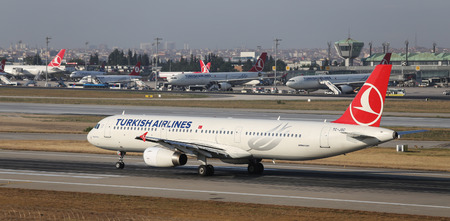 thy: ISTANBUL, TURKEY - JULY 09, 2015: Turkish Airlines Airbus A321-231 (CN 5254) takes off from Istanbul Ataturk Airport. THY is the flag carrier of Turkey with 284 fleet size and 275 destinations