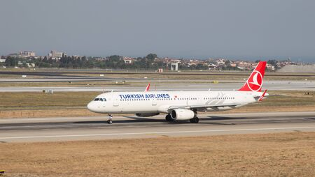 thy: ISTANBUL, TURKEY - JULY 09, 2015: Turkish Airlines Airbus A321-231 (CN 5546) takes off from Istanbul Ataturk Airport. THY is the flag carrier of Turkey with 284 fleet size and 275 destinations Editorial