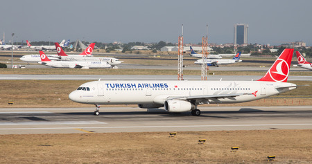 tk: ISTANBUL, TURKEY - JULY 09, 2015: Turkish Airlines Airbus A321-231 (CN 5154) takes off from Istanbul Ataturk Airport. THY is the flag carrier of Turkey with 284 fleet size and 275 destinations