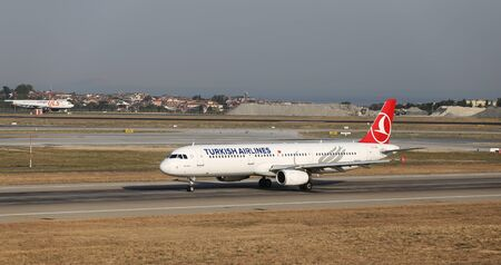 thy: ISTANBUL, TURKEY - JULY 09, 2015: Turkish Airlines Airbus A321-231 (CN 2999) takes off from Istanbul Ataturk Airport. THY is the flag carrier of Turkey with 284 fleet size and 275 destinations Editorial