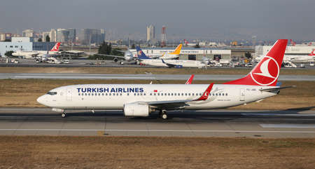 tk: ISTANBUL, TURKEY - JULY 09, 2015: Turkish Airlines Boeing 737-8F2 (CN 344131972) takes off from Istanbul Ataturk Airport. THY is the flag carrier of Turkey with 284 fleet size and 275 destinations