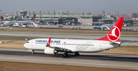 tk: ISTANBUL, TURKEY - JULY 09, 2015: Turkish Airlines Boeing 737-8F2 (CN 29776308) takes off from Istanbul Ataturk Airport. THY is the flag carrier of Turkey with 284 fleet size and 275 destinations Editorial