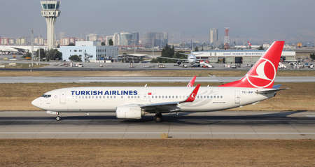 tk: ISTANBUL, TURKEY - JULY 09, 2015: Turkish Airlines Boeing 737-8F2 (CN 420004336) takes off from Istanbul Ataturk Airport. THY is the flag carrier of Turkey with 284 fleet size and 275 destinations