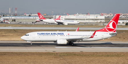 tk: ISTANBUL, TURKEY - JULY 09, 2015: Turkish Airlines Boeing 737-8F2 (CN 344111944) takes off from Istanbul Ataturk Airport. THY is the flag carrier of Turkey with 284 fleet size and 275 destinations
