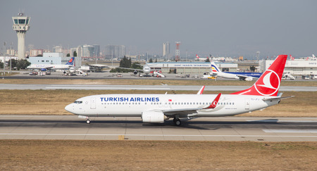 boing: ISTANBUL, TURKEY - JULY 09, 2015: Turkish Airlines Boeing 737-8F2 (CN 29772242) takes off from Istanbul Ataturk Airport. THY is the flag carrier of Turkey with 284 fleet size and 275 destinations