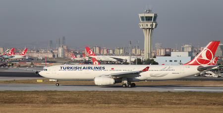 thy: ISTANBUL, TURKEY - JULY 09, 2015: Turkish Airlines Airbus A330-343 (CN 1228) takes off from Istanbul Ataturk Airport. THY is the flag carrier of Turkey with 284 fleet size and 275 destinations