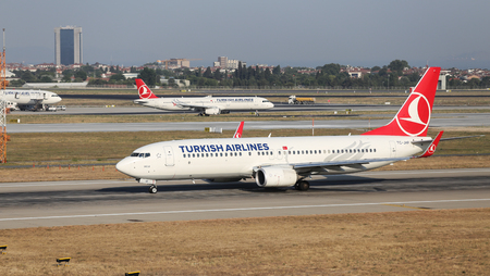 boing: ISTANBUL, TURKEY - JULY 09, 2015: Turkish Airlines Boeing 737-8F2 (CN 420004336) takes off from Istanbul Ataturk Airport. THY is the flag carrier of Turkey with 284 fleet size and 275 destinations
